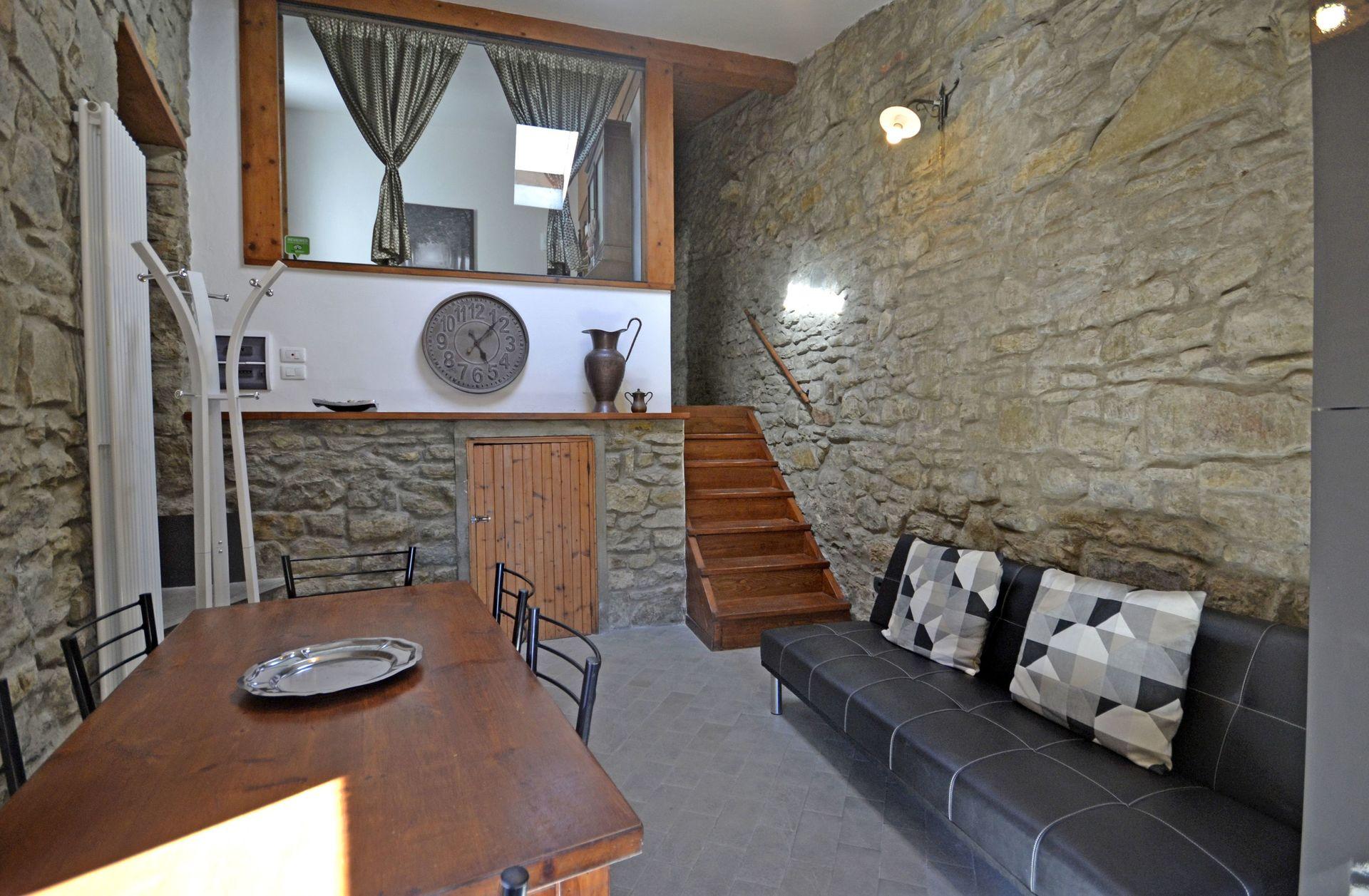 Soggiorno Con Pietra A Vista casa di pietra - casa vacanze con 4 posti letto in 1 camere